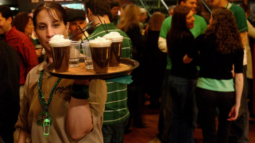 A server delivers Irish coffee