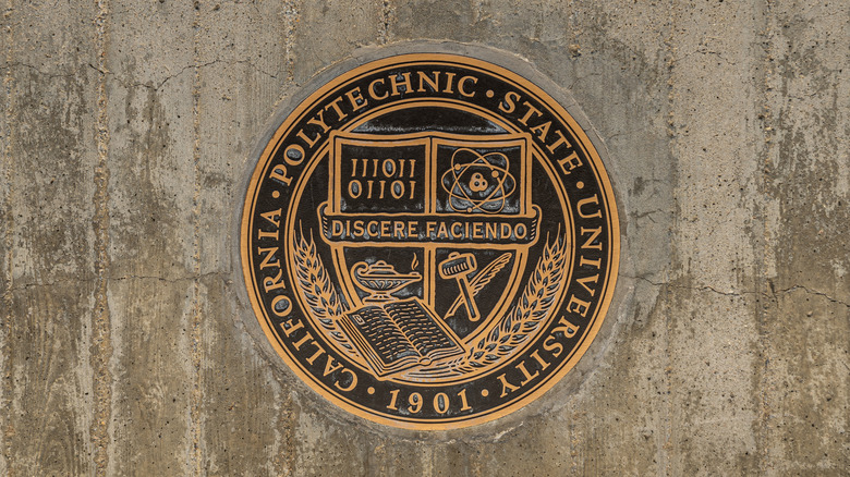 California Polytechnic State University. Closeup of gold on black Logo and metal seal on wall at entrance to campus