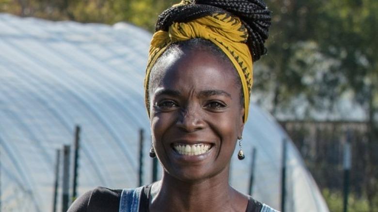 Jamila Norman smiling in denim overalls