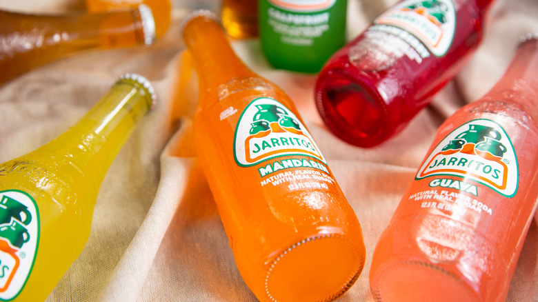 Formation of bottles of Jarritos in different flavors