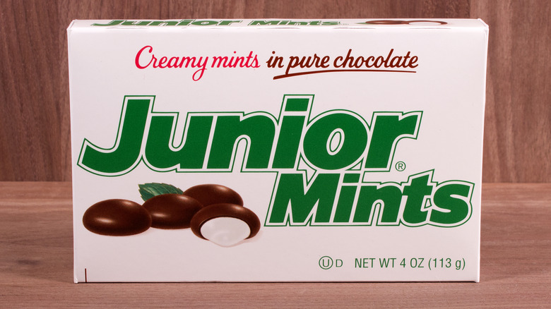 Box of Junior Mints against wooden background