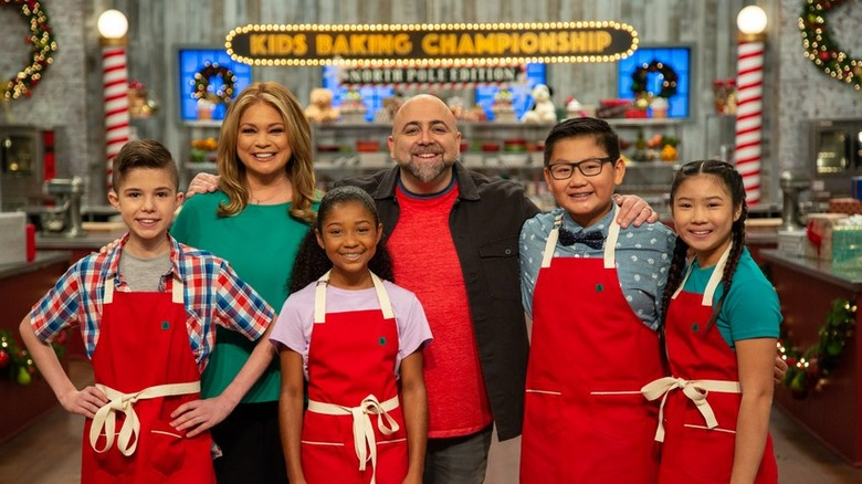 Kids Baking Championship judges with contestants