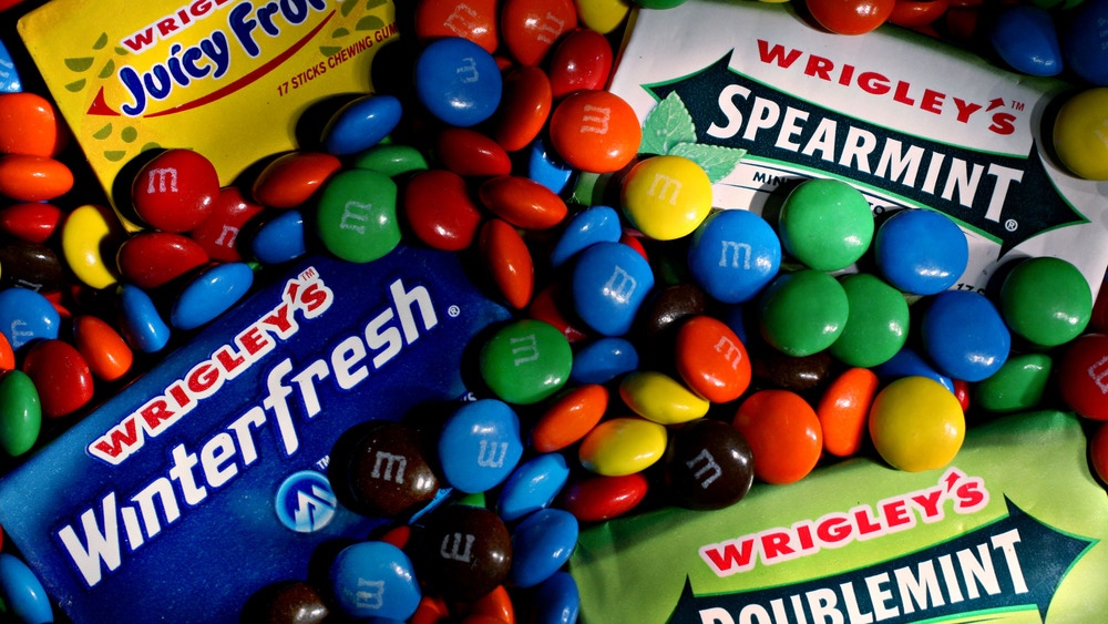 Colorful candies with packs of chewing gum