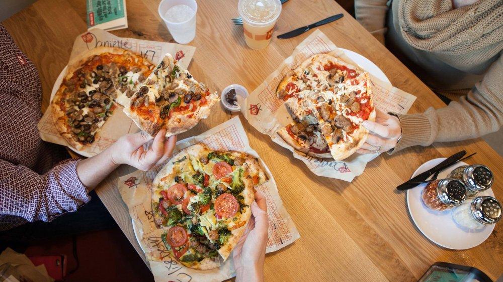 MOD pizzas on a table