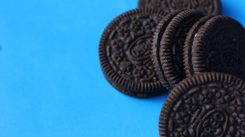 Oreo cookies and blue background