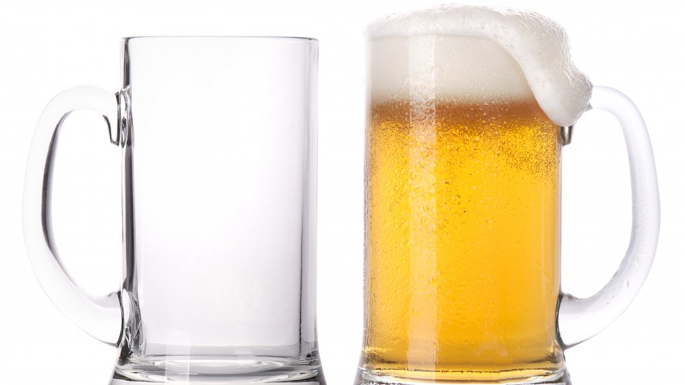 full and empty beer mugs