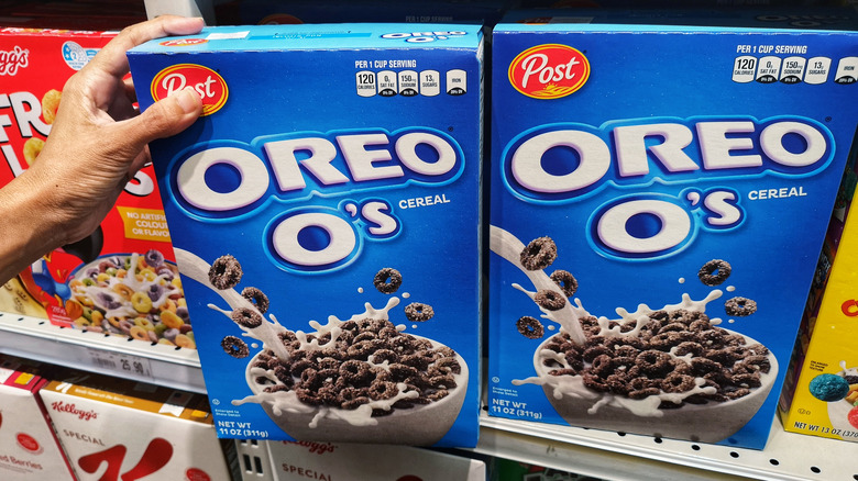 grabbing oreo o's from grocery store shelf