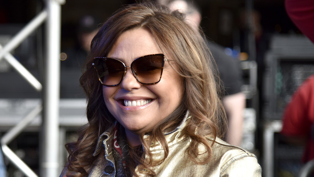 Rachael Ray smiling in sunglasses