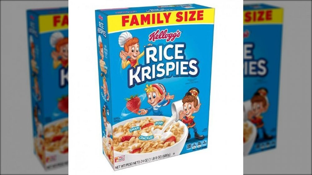 Boy with Rice Krispies boxes