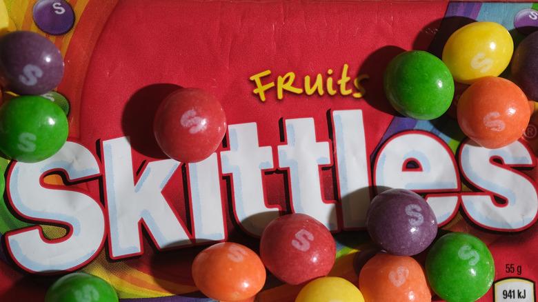 Closeup bag of Skittles and packaging