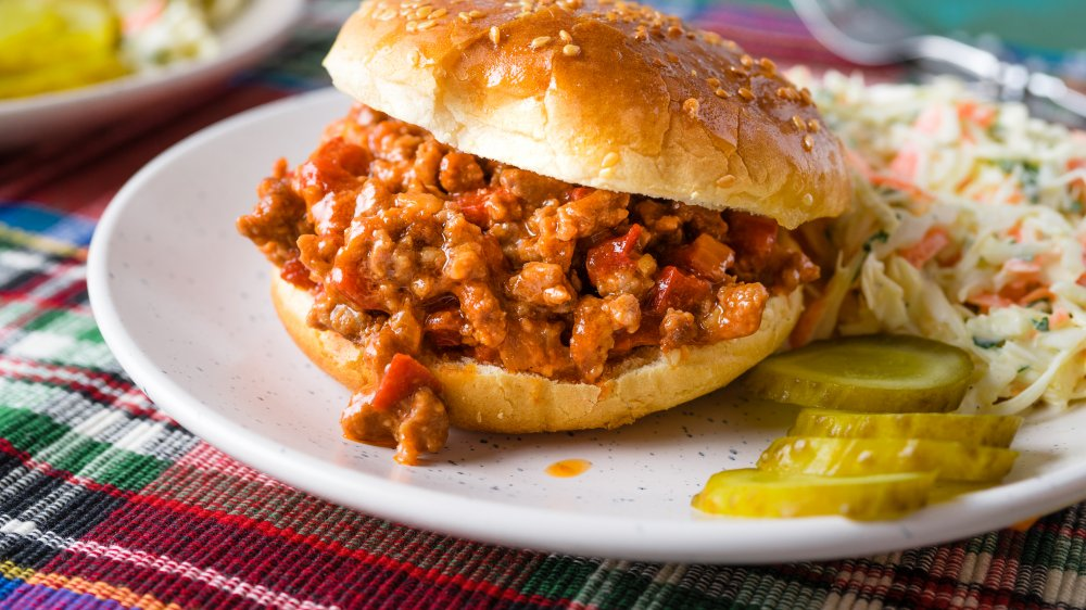 Sloppy Joe on a plate with a pickle