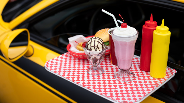 Yellow car with attached tray of food
