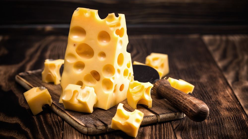 Swiss cheese on wood board