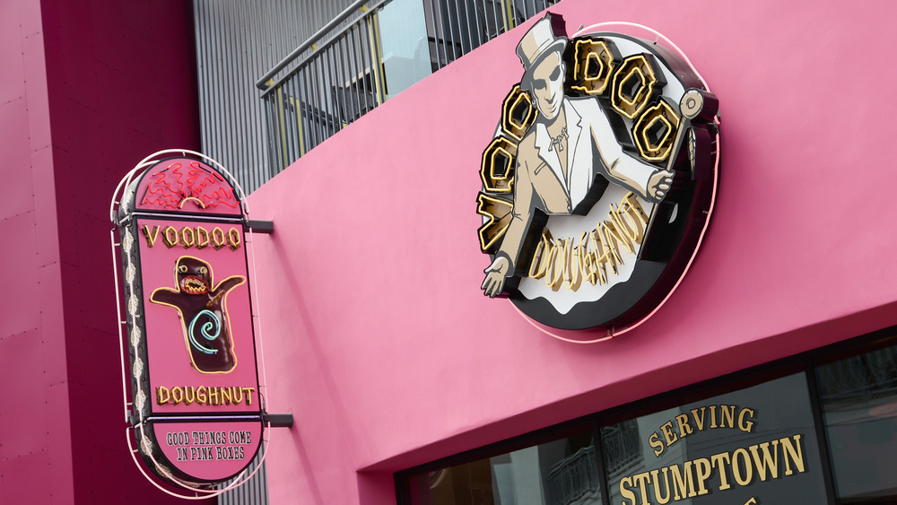 Voodoo Doughnut location signs