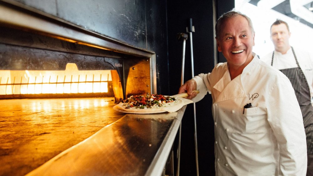 Wolfgang Puck with pizza