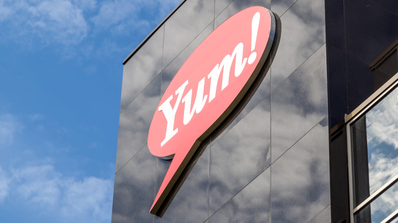 Yum brands sign on the side of a building