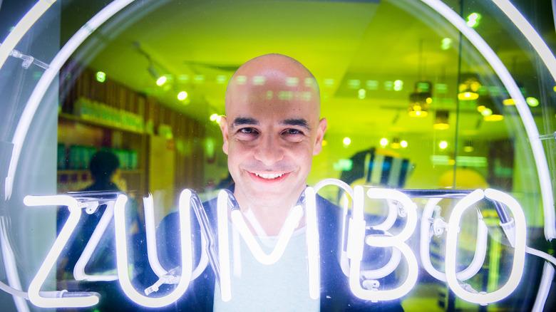 Adriano Zumbo next to neon lights