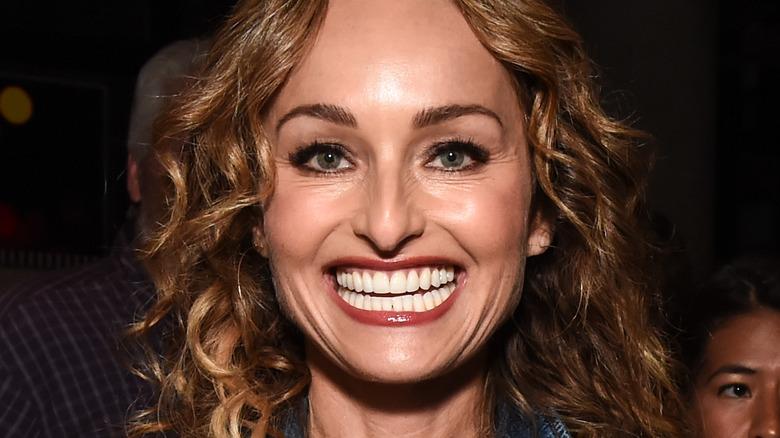 Giada De Laurentiis smiling with red lipstick
