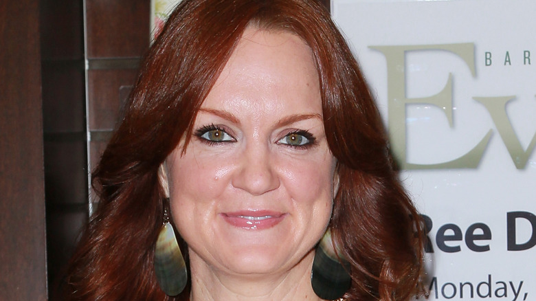 Ree Drummond wearing a white shirt and gold jewelry