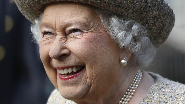 Queen Elizabeth II laughing at an event