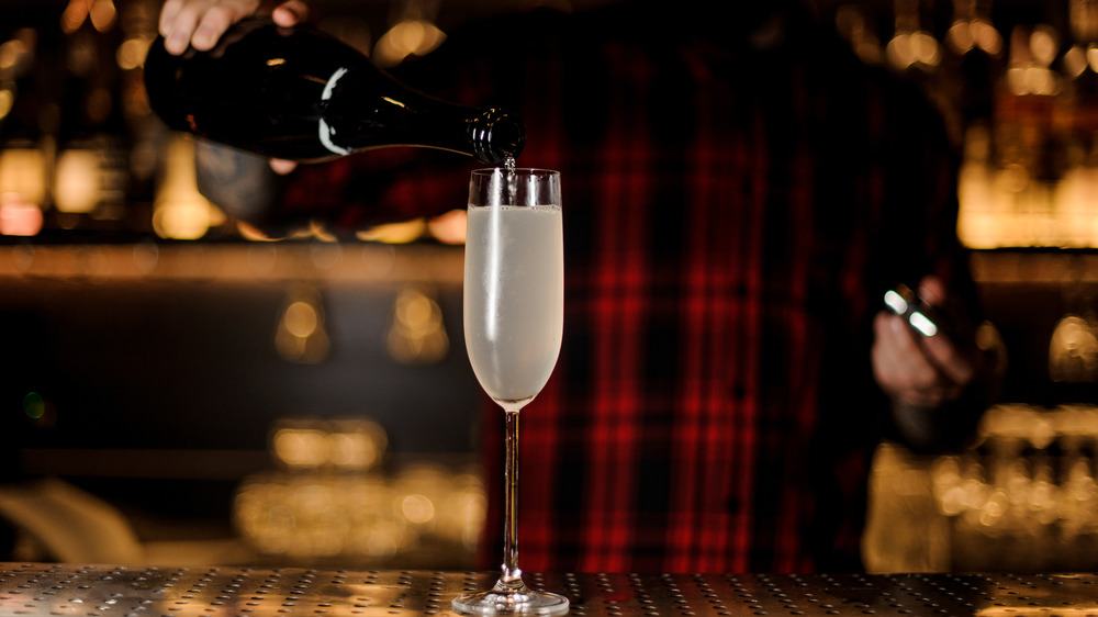 bartender making a French 75