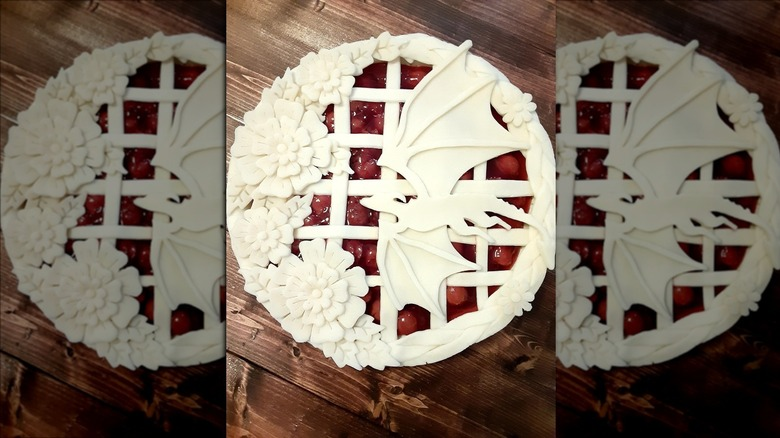 Pie crust in shape of dragon and flowers