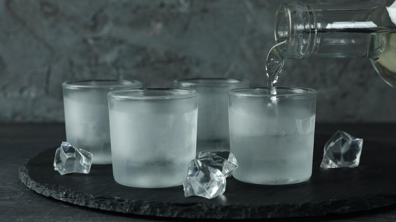 Vodka pouring into glasses