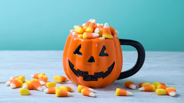 Candy Corn overflowing from pumpkin mug