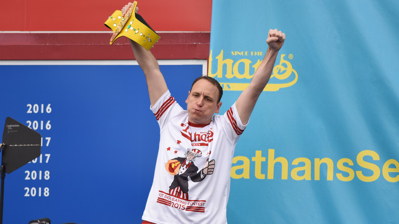 Joey Chestnut with arms up in victory