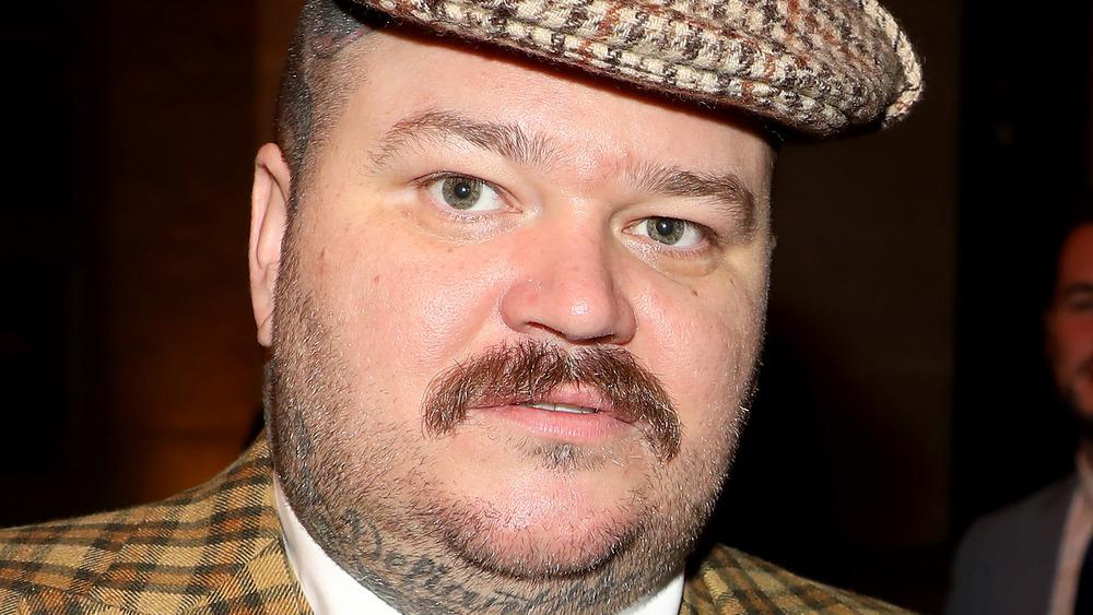 Matty Matheson grinning in hat
