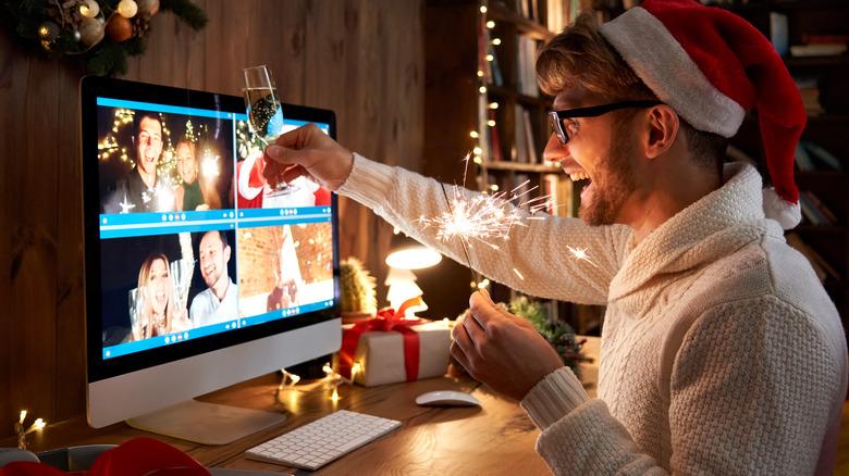 man raising a Christmas cocktails toast