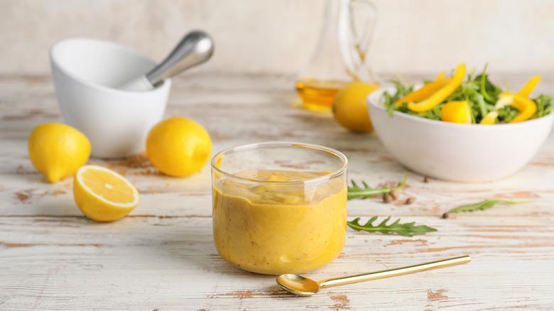 Honey mustard on table with lemons