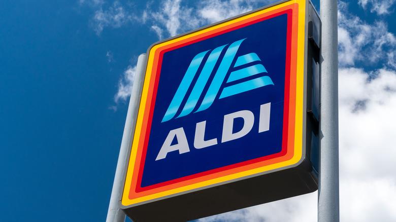 Aldi sign against blue-sky background