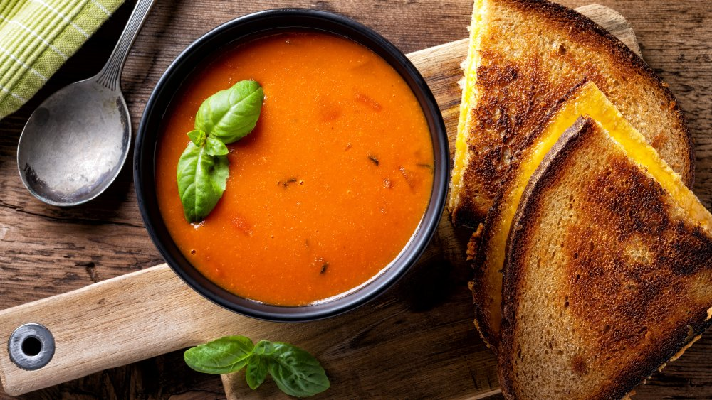 Bowl of tomato soup and grilled cheese