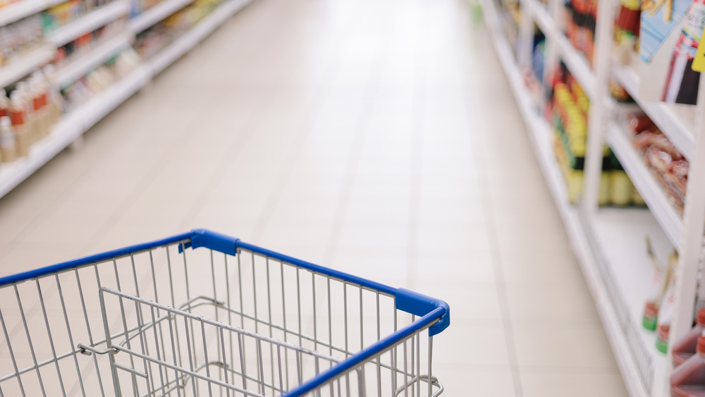 grocery store shelves and cart