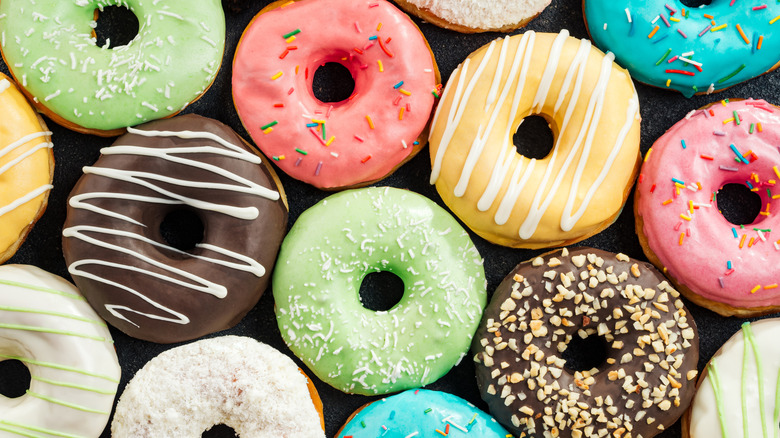 Assortment of donuts with colorful frosting and decoration