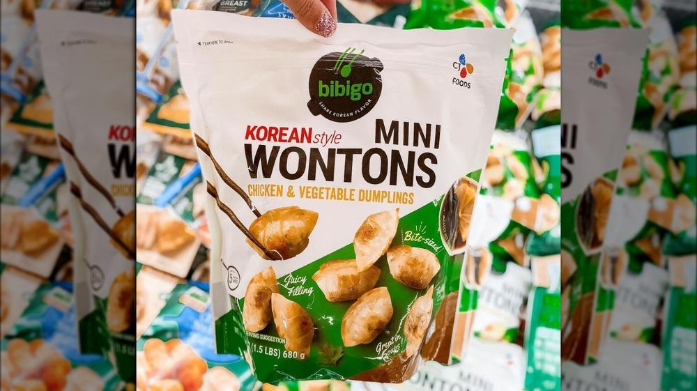 Holding Bibigo Korean-style mini wontons