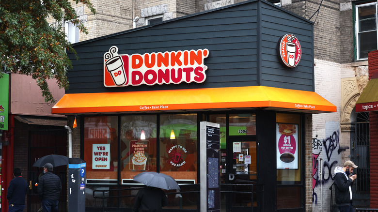 Dunkin' Donuts storefront in rain