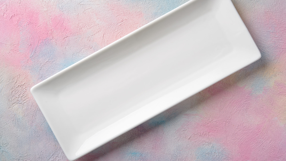 empty white serving tray on multi-color background