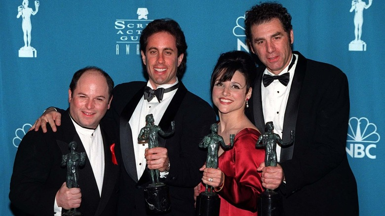 The cast of Seinfeld holding SAG Awards statues