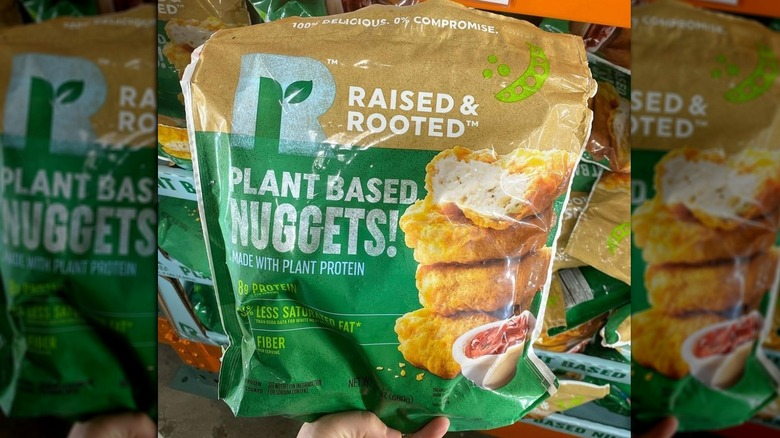 A hand holding a bag of the new nuggets
