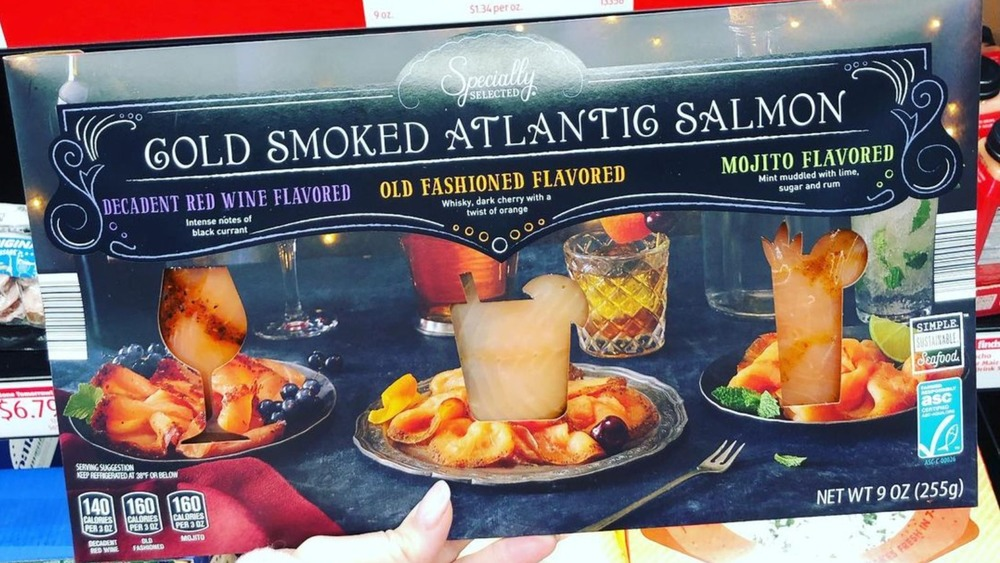 Hand holding Aldi smoked salmon