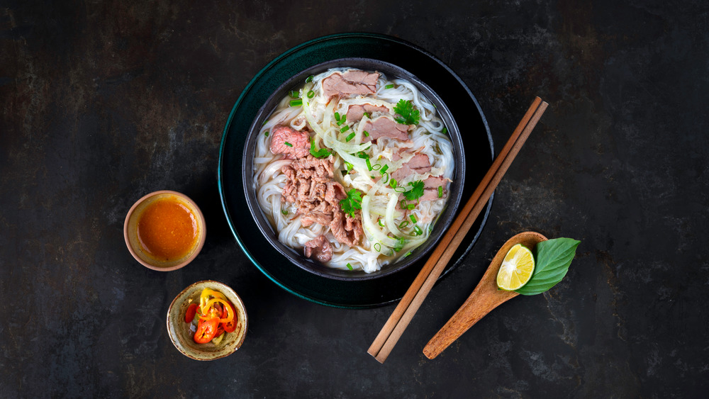 Bowl of pho on a black background