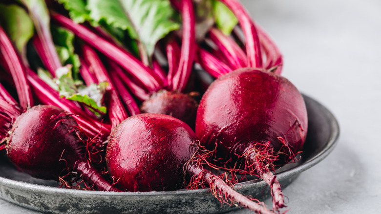 Fresh beets on a gray plate