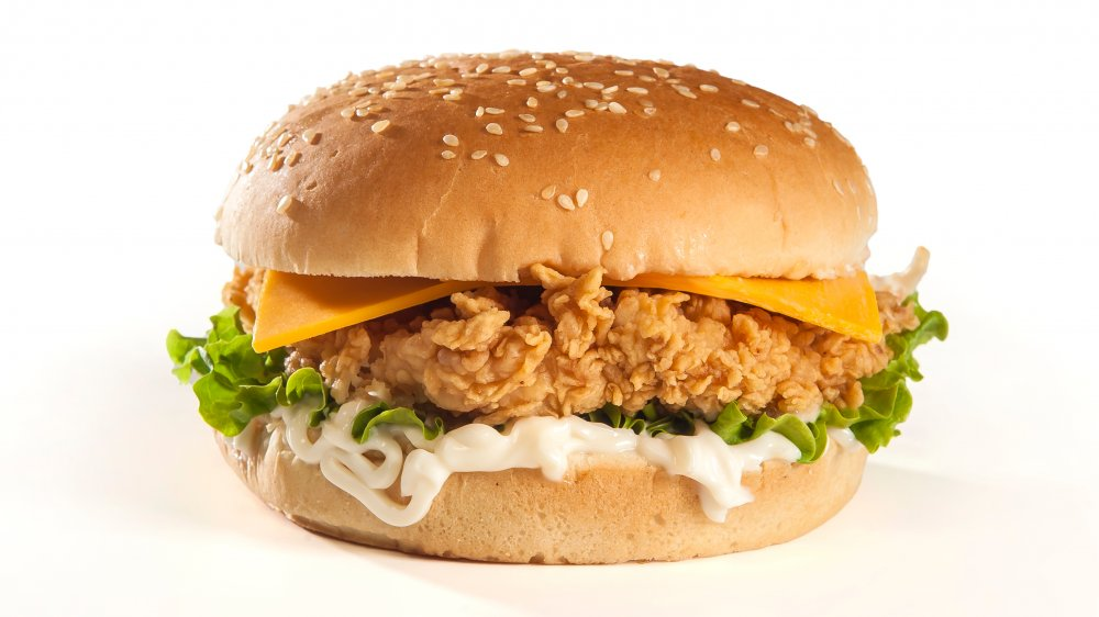 Fried chicken sandwich with mayo, lettuce, and cheese