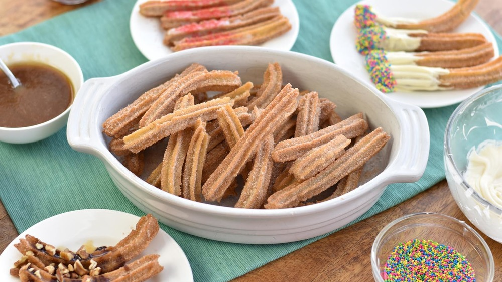 plates of churros with sprinkles