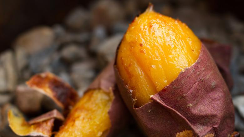 baked, partially peeled sweet potato
