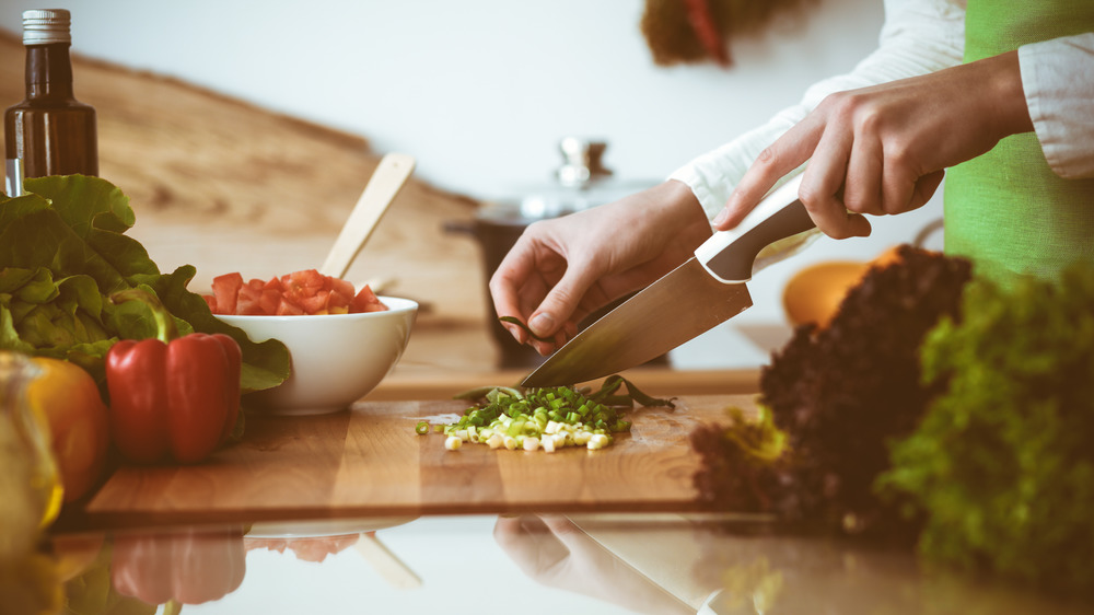 Person cutting vegetables on a cutting board