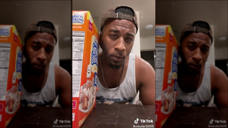 Person holding box of cereal