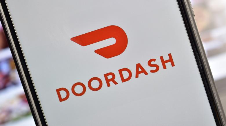 DoorDash logo on phone